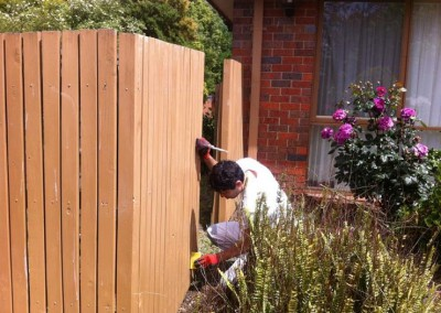 Team member doing prep work on a fence